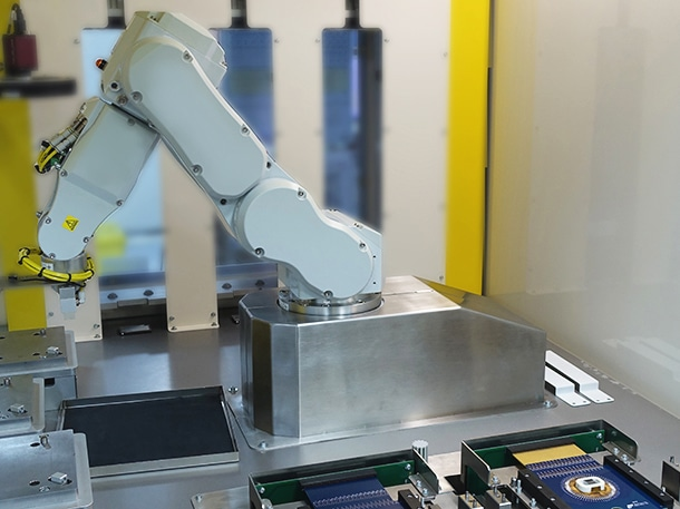 In Line Test Production station with robotic arm