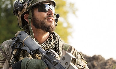 Solider with a weapon and communication gear