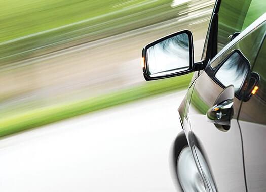High-tech car speeding in blurred background