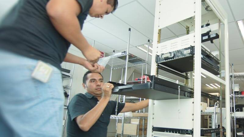 Test engineers assembling a test station