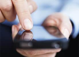 Hands swiping across a cellphone